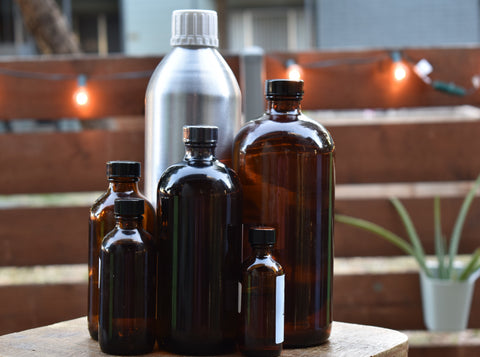 Photo of six essential oil bottles