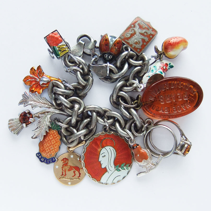 Charm bracelet with antique and vintage enamel and crystal orange charms | Silver Star Charms