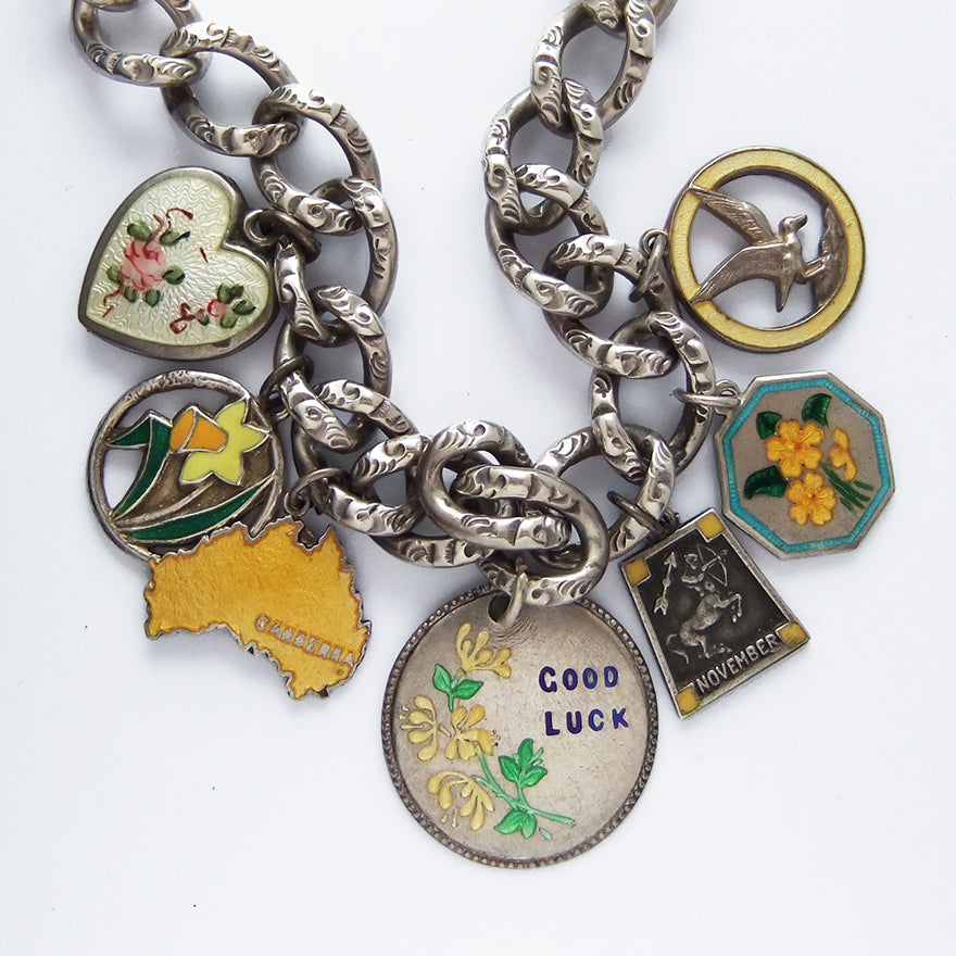 Yellow Antique and Vintage Charms on Charm Bracelet | Silver Star Charms