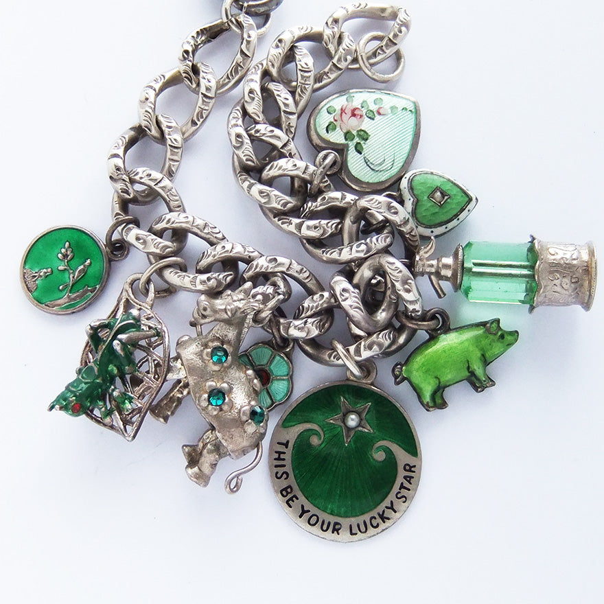 Charm bracelet with antique and vintage enamel and crystal green charms | Silver Star Charms