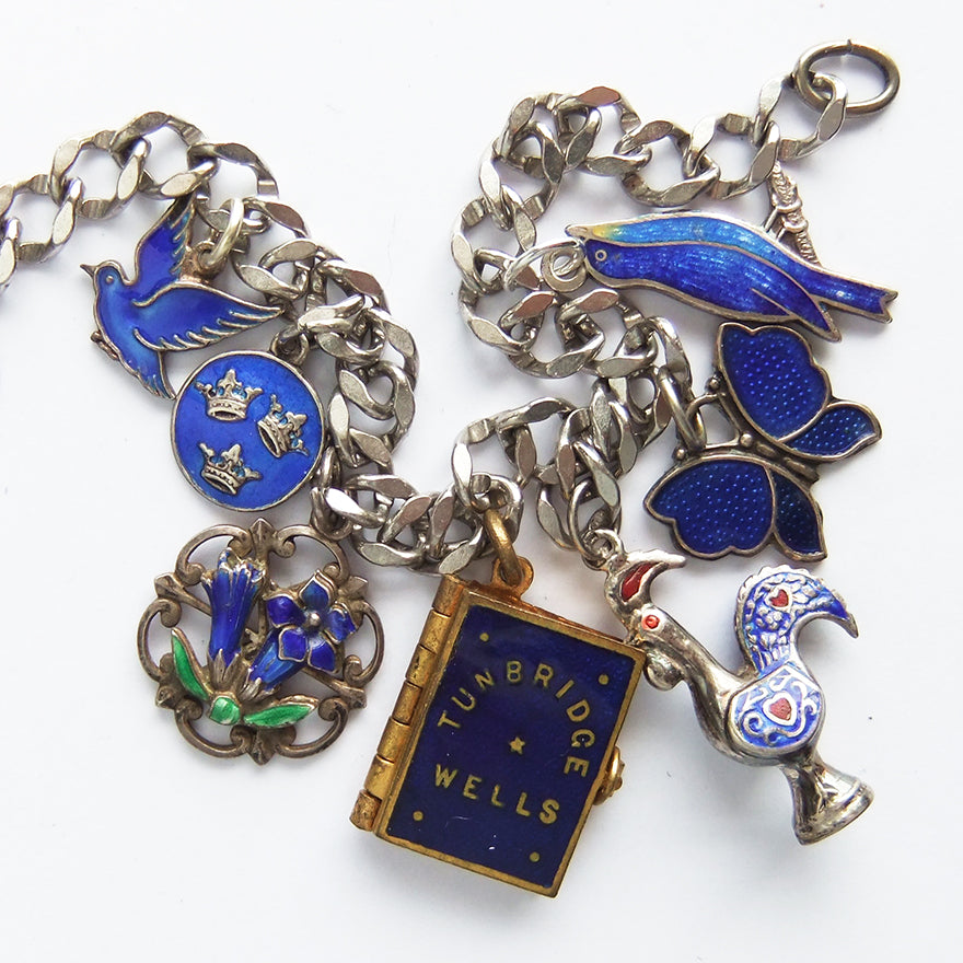 Charm bracelet with antique and vintage enamel and crystal indigo charms | Silver Star Charms