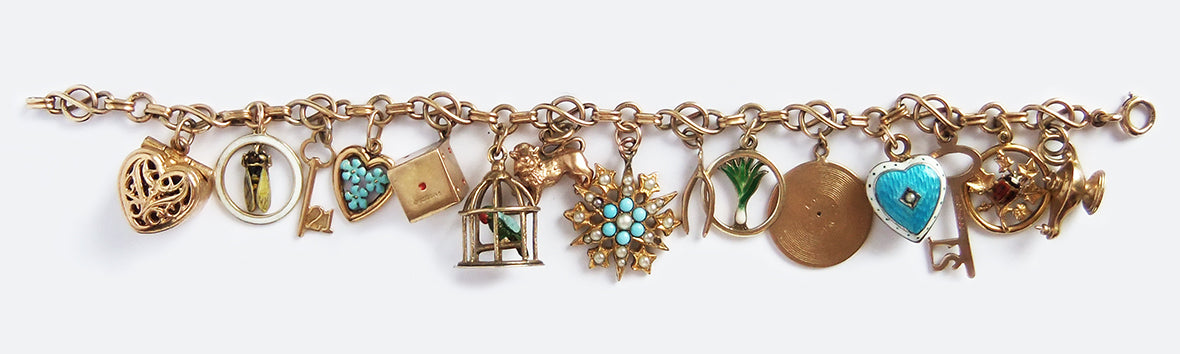 Vintage and antique gold and enamel charm bracelet