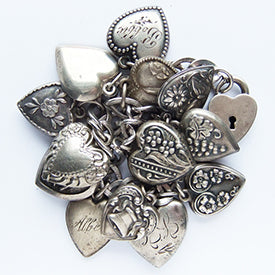 Antique and vintage sterling silver ornate puffy heart charm bracelet | Silver Star Charms