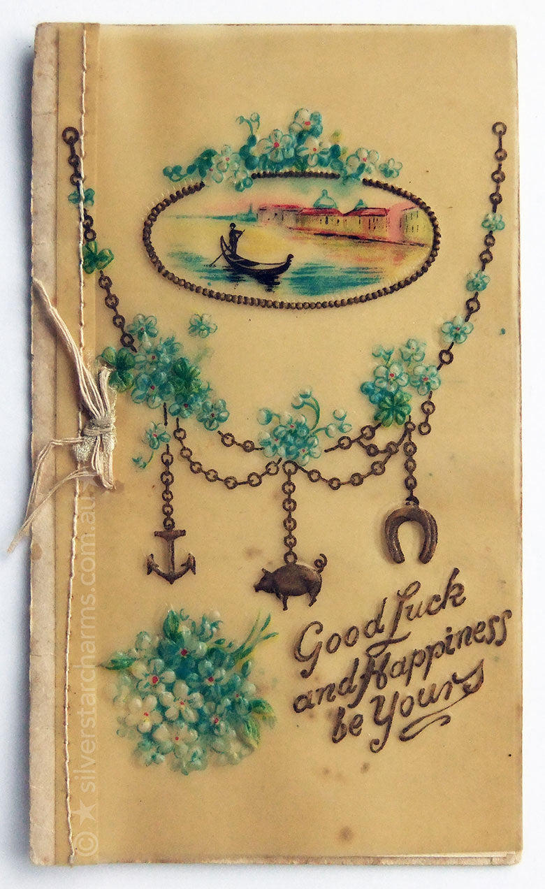 Antique postcard with charm bracelet