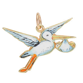 Stork and baby gold and enamel charm