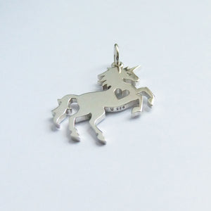Rearing unicorn silhouette charm with heart cutout