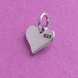 Tiny sterling silver heart and animal paw print charm