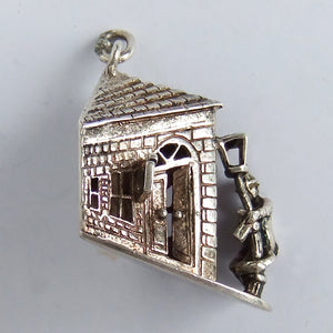 Vintage silver drunk person holding lamppost outside pub charm