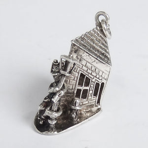 Vintage silver drunk person and bottle by lamppost outside pub charm