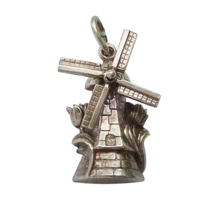 Vintage windmill charm with rotating sails and tulips
