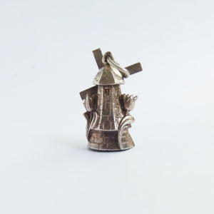 Vintage Dutch windmill charm with moving sails and tulip flowers