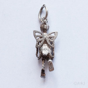 Vintage moving mechanical silver flower fairy charm
