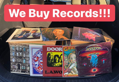 """""""We Buy Records"""" over image of vinyl records"""