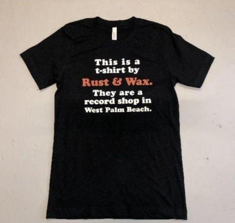 "Rust & Wax tshirt that reads ""This is a T-shirt by Rust & Wax. They are a record shop in West Palm Beach."""