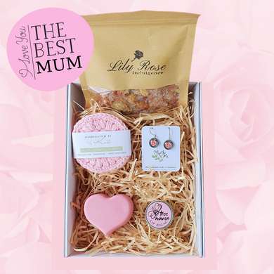 Mothers Day white gift box with silver drop earrings, natural lip balm, rose bath salts, soft cotton face scrubbies and a pink heart soap for Mum