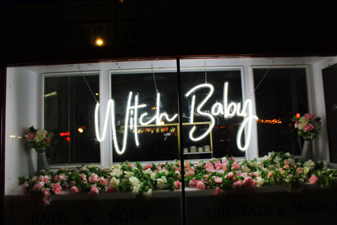 Neon sign in the window of Witch Baby's Cranford storefront