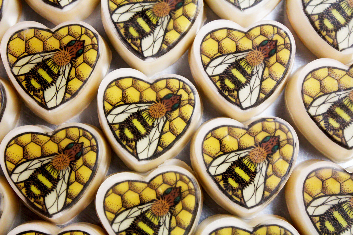 Image of Honey Pot Soap -  a yellow soap with old school tattoo style art of honey comb and a bee