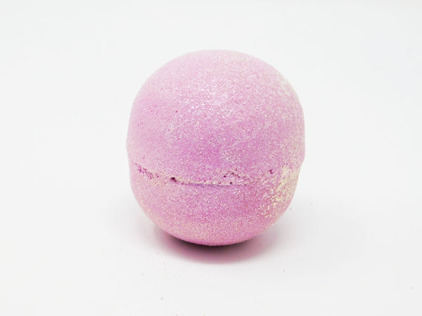 Pink bath bomb with bio degradable pink glitter. Pink bath bomb that smells like cotton candy. Pink bath bomb with rose quartz inside. Bath bomb that turns your bath water pink.