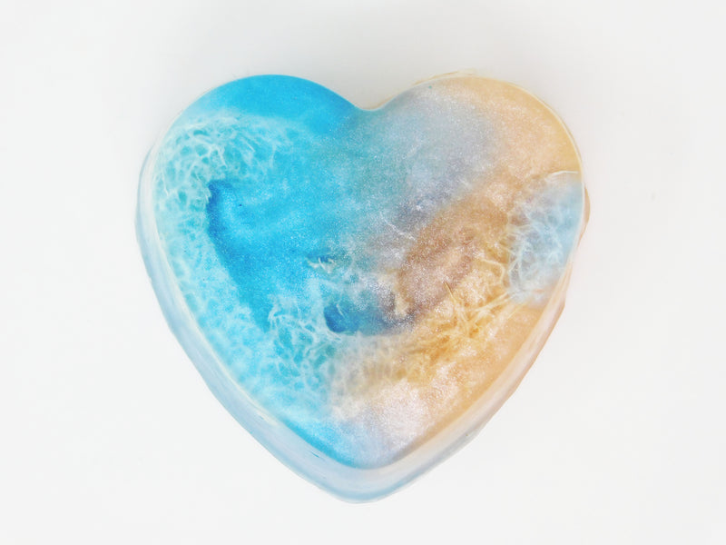 Cloud 9 is a heart shaped sky blue and peachy cloud colored soap with loofah inside. It's scented in coconut marshmallow and hibiscus.