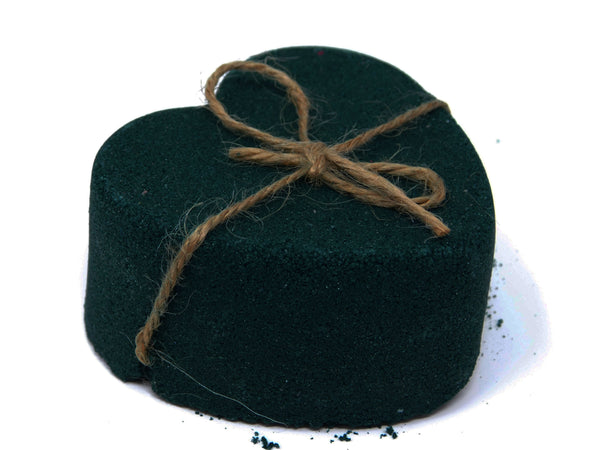 side view of Black heart bath bomb with cord around it to cut in a witchcraft cord cutting ritual