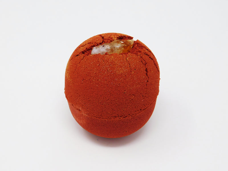 Red bath bomb that smells like dragon's blood. Red bath bomb covered in gold bio degradable glitter.