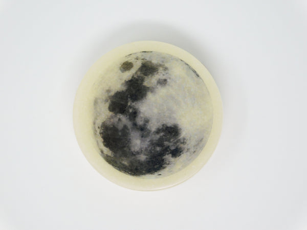 Glycerin soap with the image of a full moon on top. Glycerin soap that smells like coconut and lemongrass.
