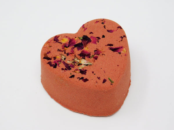 Heart shaped bath bomb that turns the bath water red. Heart shaped bath bomb with roses in it.