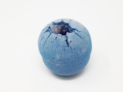 Blue bath bomb with silver bio degradable glitter. Bath bomb that turns your water purple.