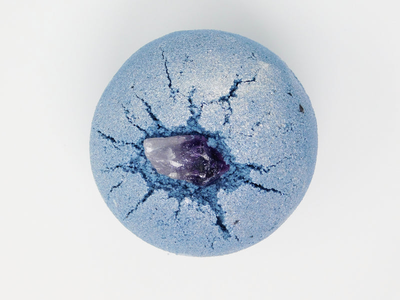 Blue bath bomb topped with Amethyst. Bath bomb that smells like lavender and amber.