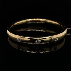 18ct yellow gold bangle set with 3 old cut diamonds