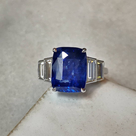 Sapphire ring with trapezoid diamond shoulders