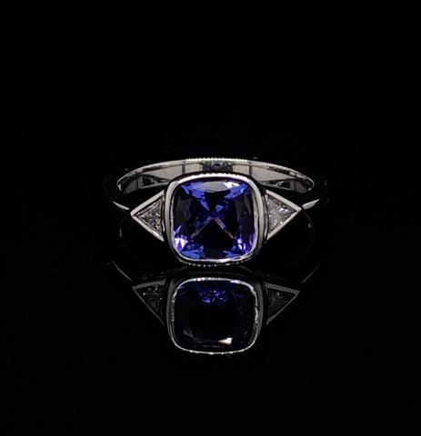 Tanzanite ring with trillion cut diamonds