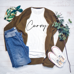 Plus size curvy graphic tee with Curvy screen printed on the front. This tee is super soft and has a looser women cut to flatter a curvy figure.
