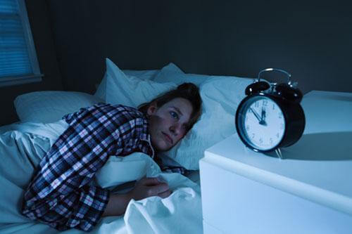 woman with insomia and cant sleep