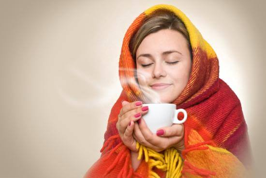 woman drinking tea to help sleeplessness