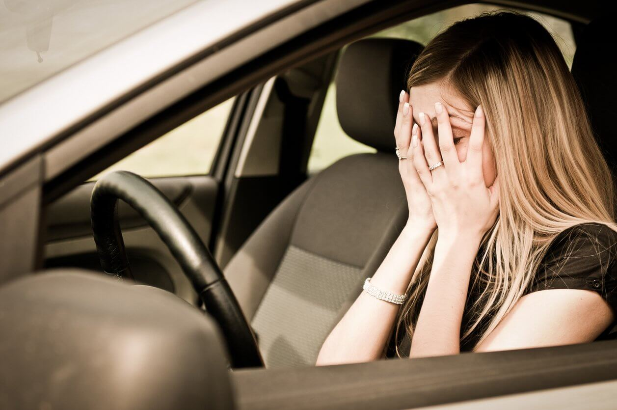 woman stressed in car
