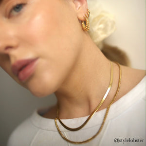 Emily Parr in the Anisa Sojka Gold Flat Snake Necklace, Square Edge Necklace and Croissant Hoop Earrings