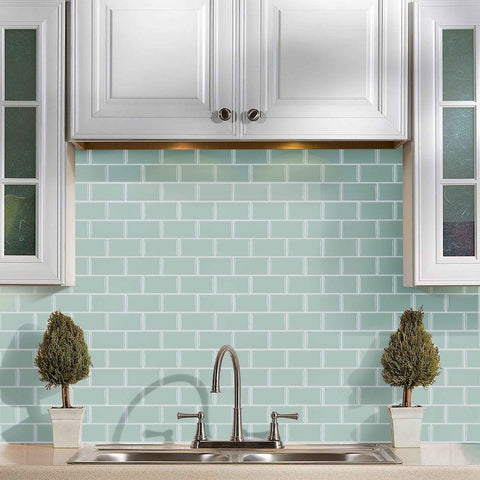 mint green tiled backdrop in the kitchen