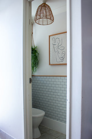 After photo of toilet using tile stickers