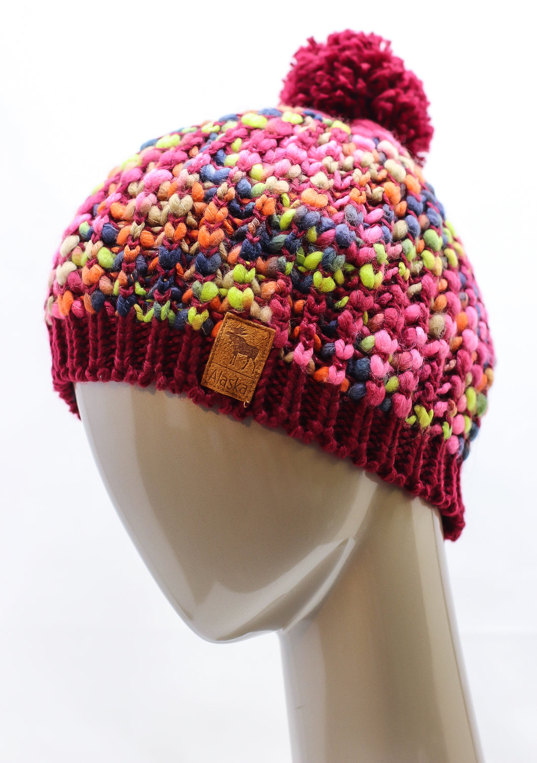 MULTI-COLORED KNITTED HAT WITH POM-POM