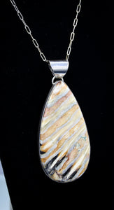 FOSSILIZED WOOLY MAMMOTH TOOTH PENDANT