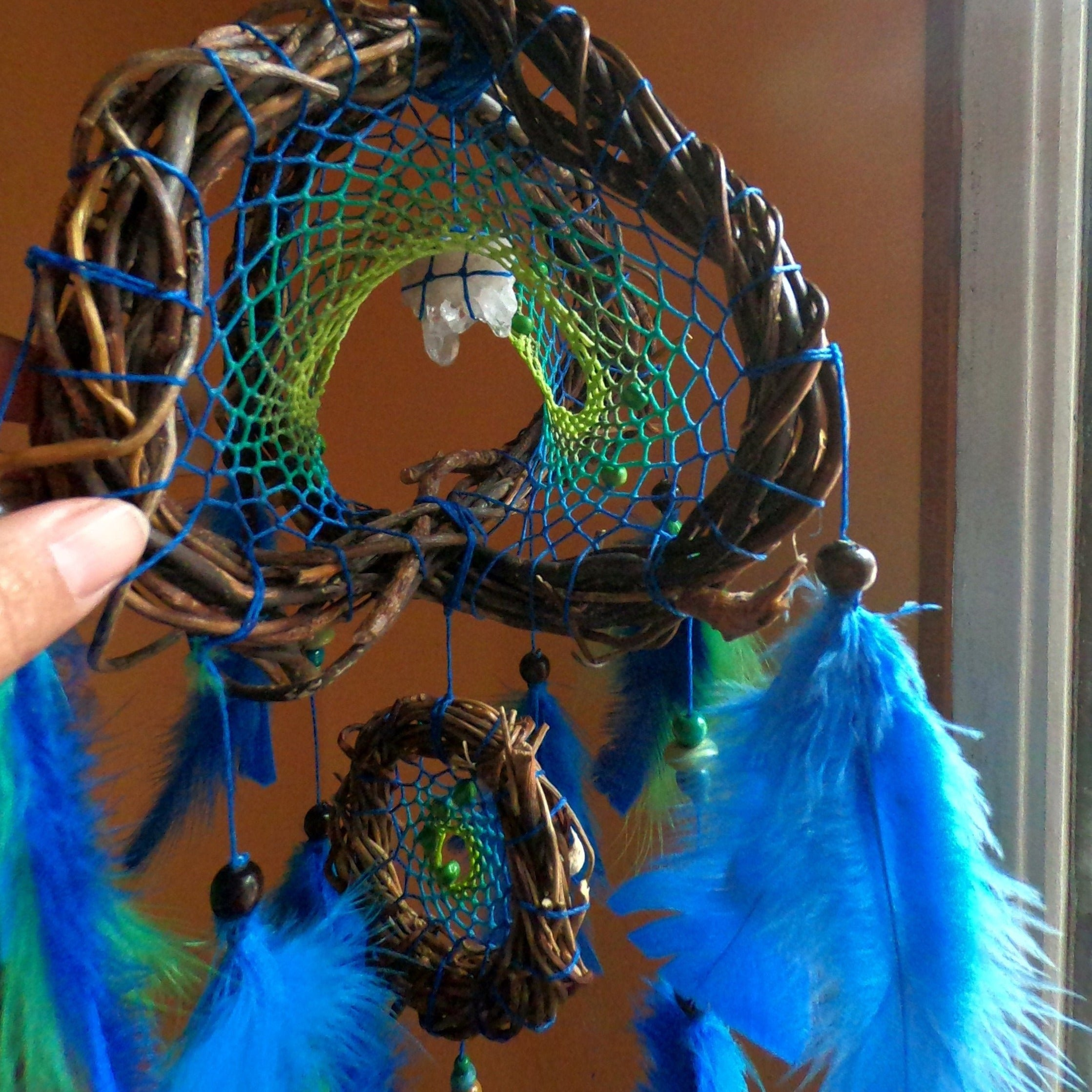 Small three-dimensional mobile dream catcher, blue green with natural feathers, Willow