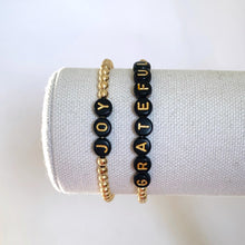 Load image into Gallery viewer, Black and Gold Letter Bead Bracelet