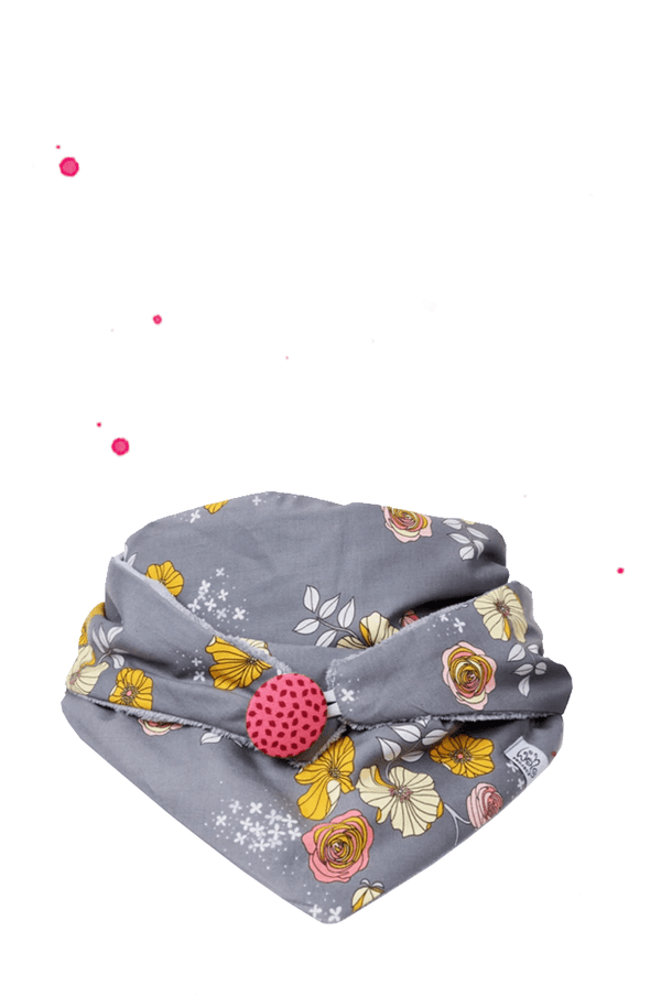 Grey triangular stuches with pink button Flower pattern