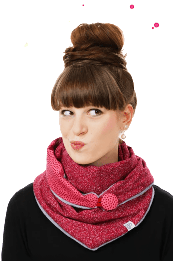 Girl wears a pink triangular scarf with a button