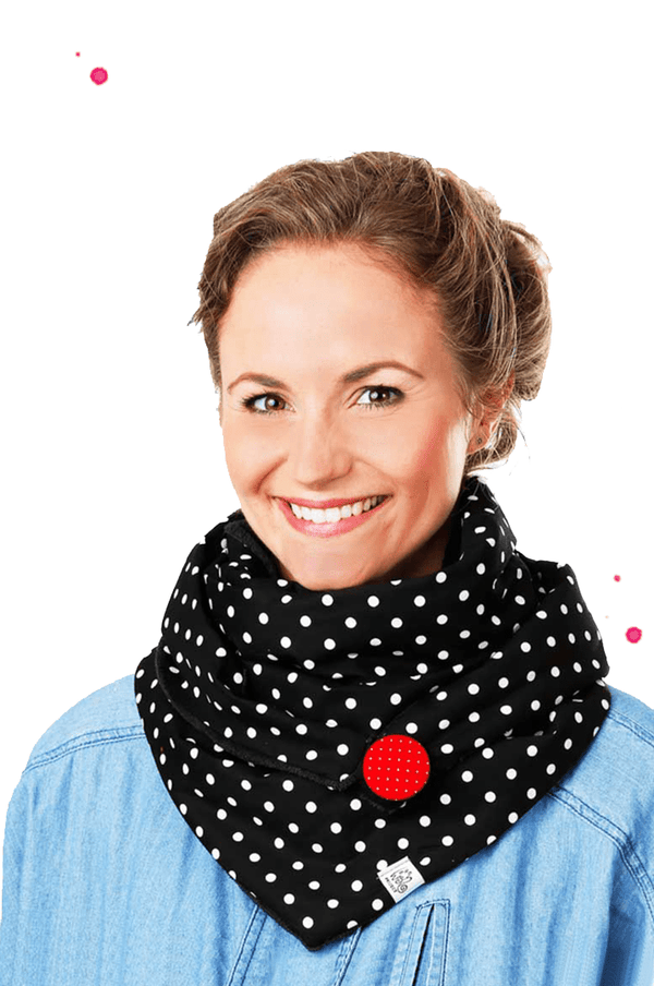 Young woman wearing black triangular studs with red button and large white dots