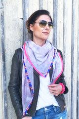 Young woman wearing xxl scarf ladies altrosa velours leather imitation soft vegan with neon pink border and stripes