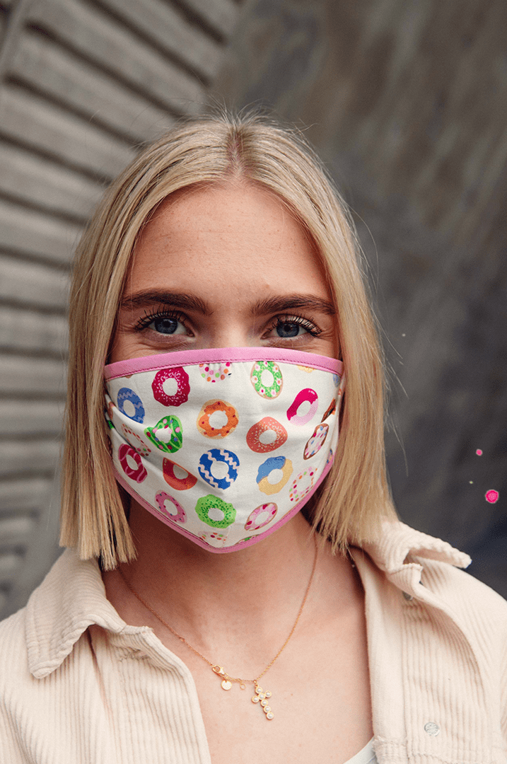 Girl with face mask with donuts