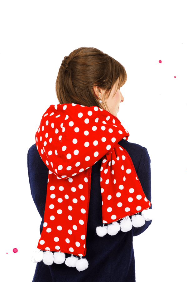 young woman wears hooded scarf red with white dots and bobble