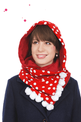 young lady wears red hooded scarf with large white dots and white pompons on the ends